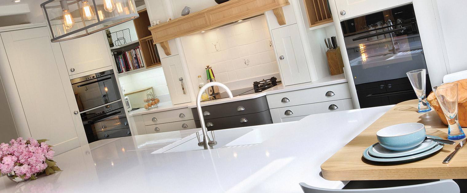White kitchen island with boiling hot water tap