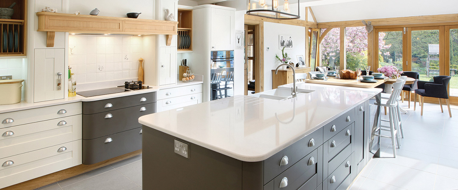Family famhouse kitchen in cream and dark grey, deco rounded units and pale blanco norte silestone quartz kitchen island worktop