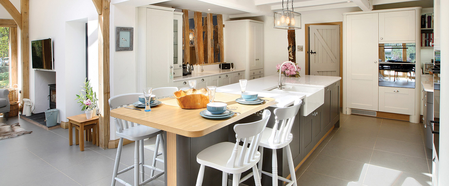 Traditional farmhouse kitchen with kitchen island seating and belfast sink