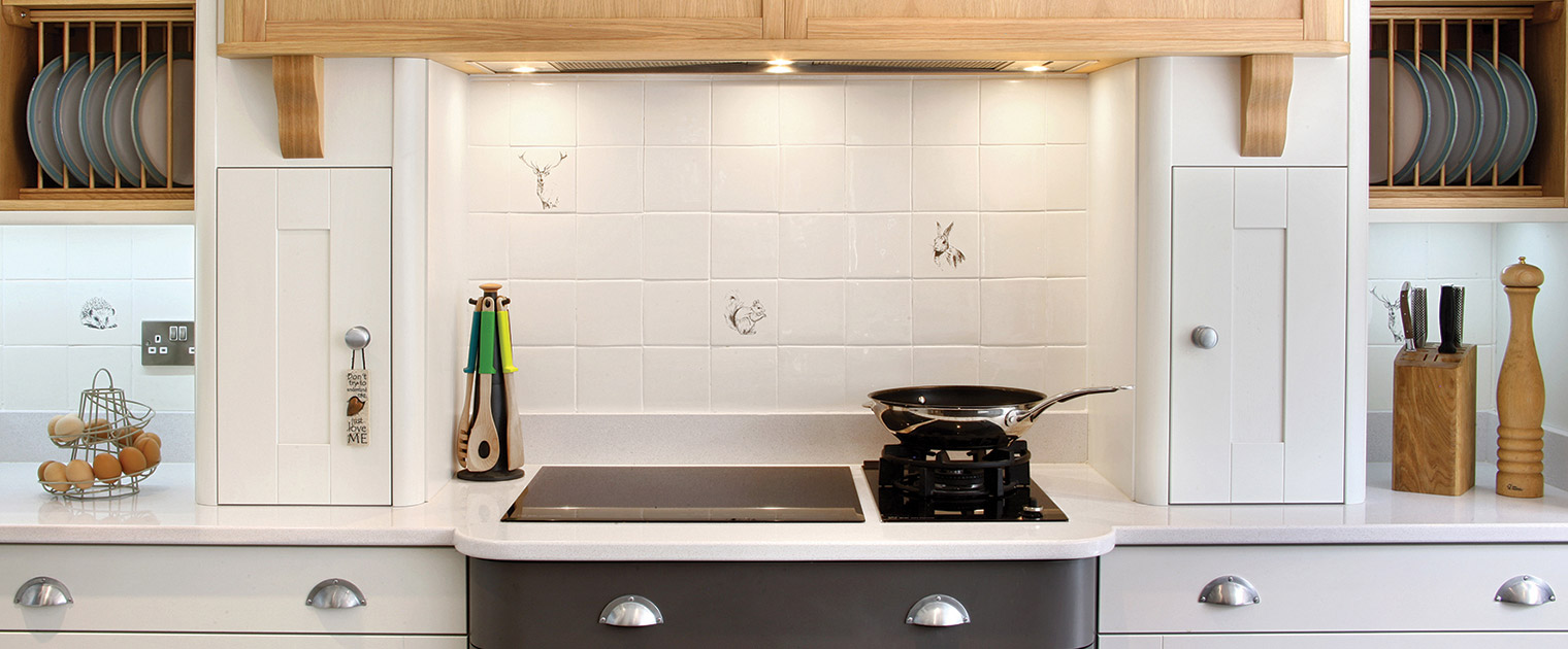 induction hob with wok burner, open plate racks, white tile splashback and deco grey and white base cabinets