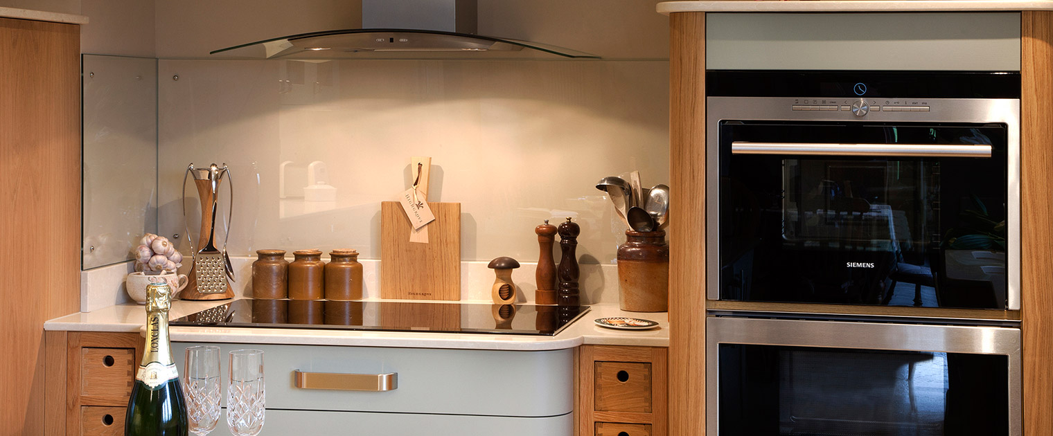 Traditional Oak and duck egg kitchen with induction hob, dual ovens and integrated appliances