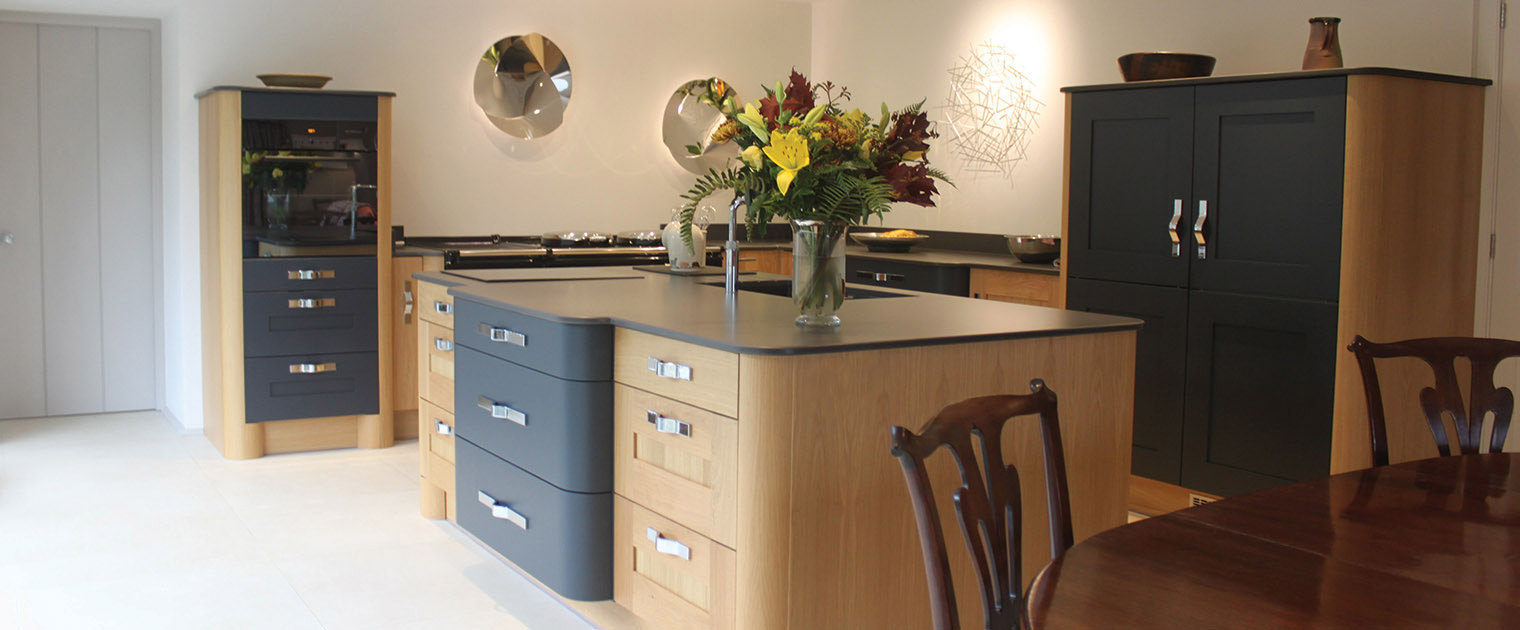 Traditional oak and dark grey kitchen open plan with large island kitchen storage