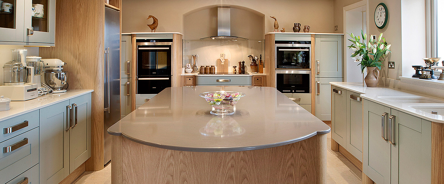 Silestone quartz kitchen island in traditional family kitchen