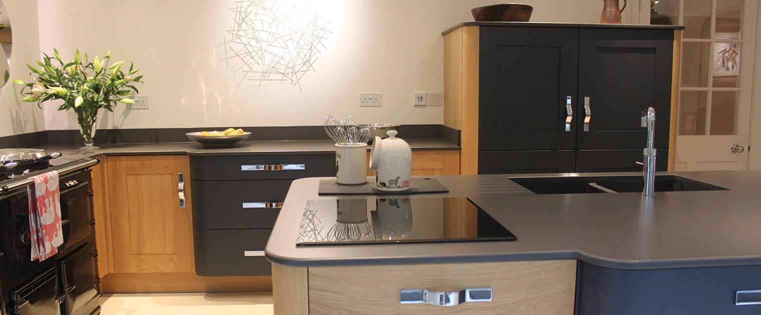kitchen island with induction hob, undermounted sink and boiling hot water tap