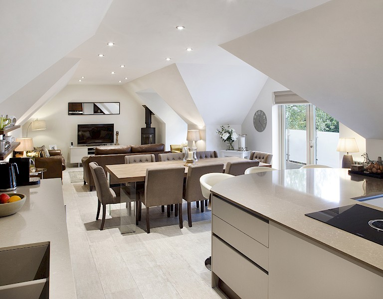Contemporary open plan kitchen dining living space with Callerton Cashmere and Walnut kitchen