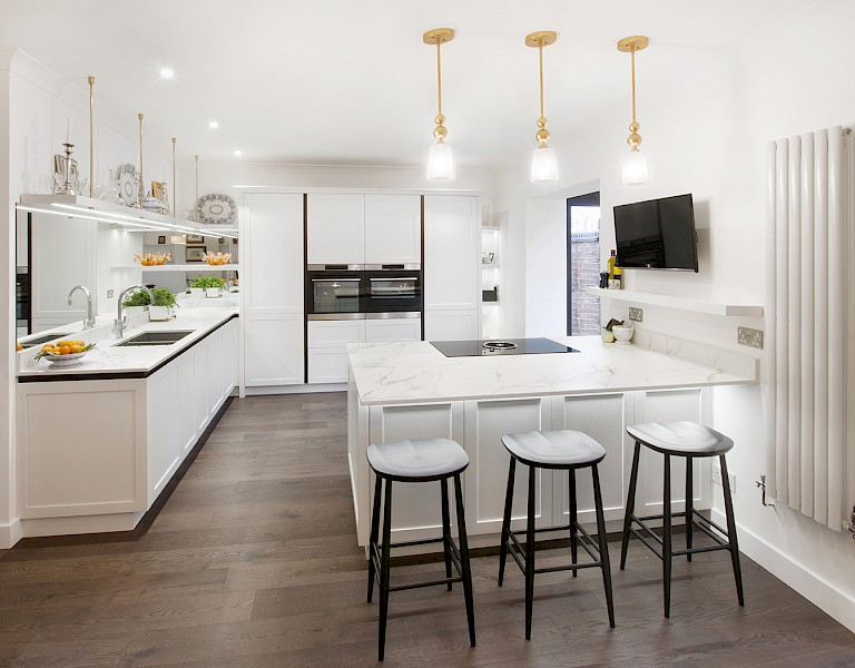 White handleless shaker kitchen open plan with kitchen island and stools
